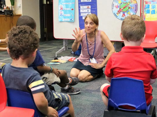 "Westfield teacher Dianne Smith leads 3-year-olds in an expressive version of ""Five Little Ducks"" during a preschool class at the Westfield Public School District's  extended school year program."