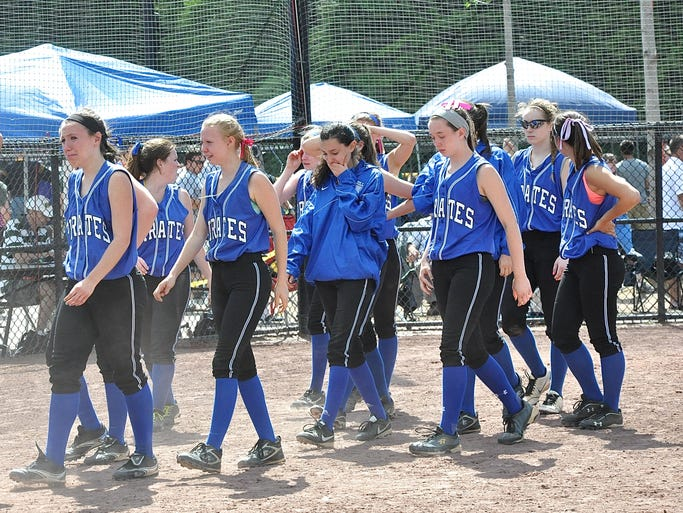 Pearl River walks off field after state semifinal loss to Section 11Õs Sayville during the Class A softball state semifinals at at Moreau Recreation Park in South Glens Falls, June 14, 2014. Pearl River lost to Sayville, 4-2.