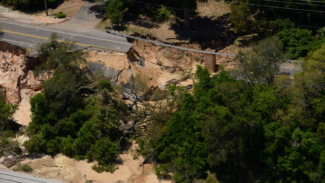 Scenic Highway view from the air six days after flooding caused the road and the bluffs to collapse.