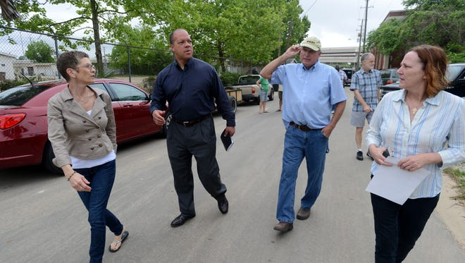 State Rep. Mike Hill meets with residents of the Long Hollow neighborhood Friday who were swamped with flood water. Many of the residents had questions regarding electrical wiring in their homes after the flood and the condition of a nearby water retention pond that may be the cause of the extreme flooding in the area.