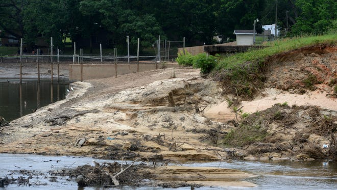 Crescent Lake has been reduced to a swampy mud flat after the lake's earthen dam was breached during the recent heavy rain.