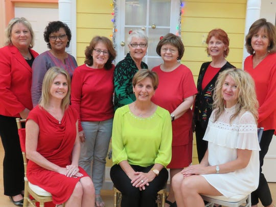 The 2017 Poinsettia Power planning committee: back row, from left, Karen Ripper, Komal Manghra, Karen Helmers, Bonnie Ares Royster, Brenda Baker, J.C. Stern, and Vicky Mason. Front row: Hilary Schmidt, Linda Ryan, and Elizabeth Jacklin.