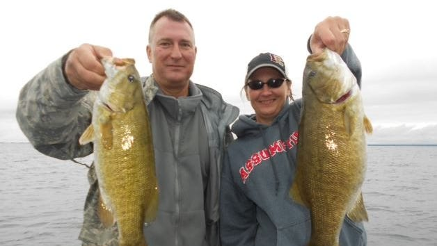 Hank Siebert from DePauw, Indiana and Anne Fenske from Dewitt, Iowa with a pair of big bass caught in August 2014 on Chequamegon Bay.