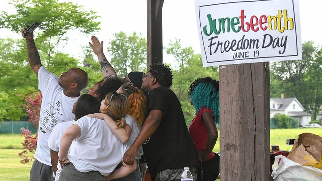 People gathered at Nimisilla Park in Canton to celebrate Juneteenth, a celebration of the ending of slavery in the United States, June 19, 2020.