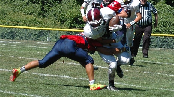 Scarsdale's Stephen Nicholas (white) is tackled by