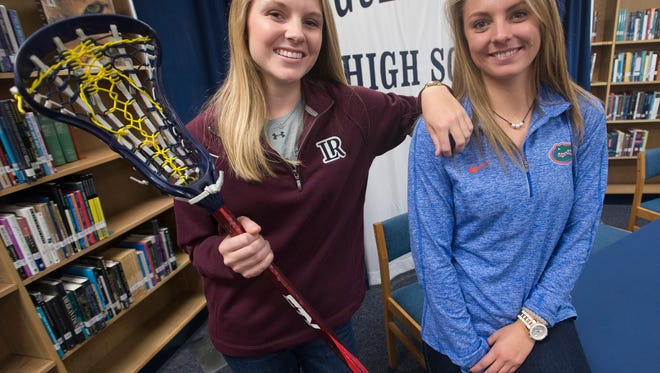Gulf Breeze High School athletes Frances Williams, left, and Tori Bindi, right have both signed to continue their sports careers in college. Williams signed to play Lacrosse at Lenoir-Rhyne University and Bindi signed to swim at the University of Florida.