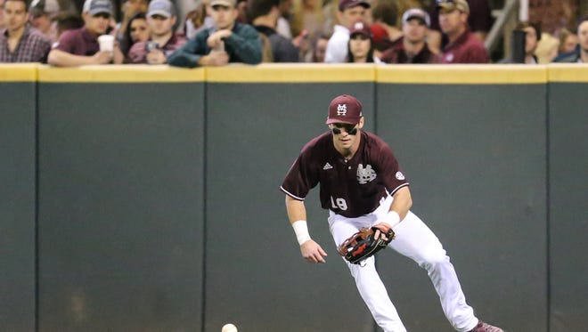 Mississippi State's Brent Rooker (19) fields a ball in right field. Mississippi State played Texas Tech in the 2017 baseball season-opener on Friday, February 17 at Dudy Noble Field in Starkville. Photo by Keith Warren
