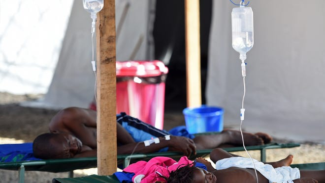Patients lie in stretchers in the Ebola treatment center in Kenema, Guinea, run by the Red Cross.