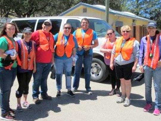 Representatives of the Boys and Girls Club of Sierra Blanca pitched in to collect trash.