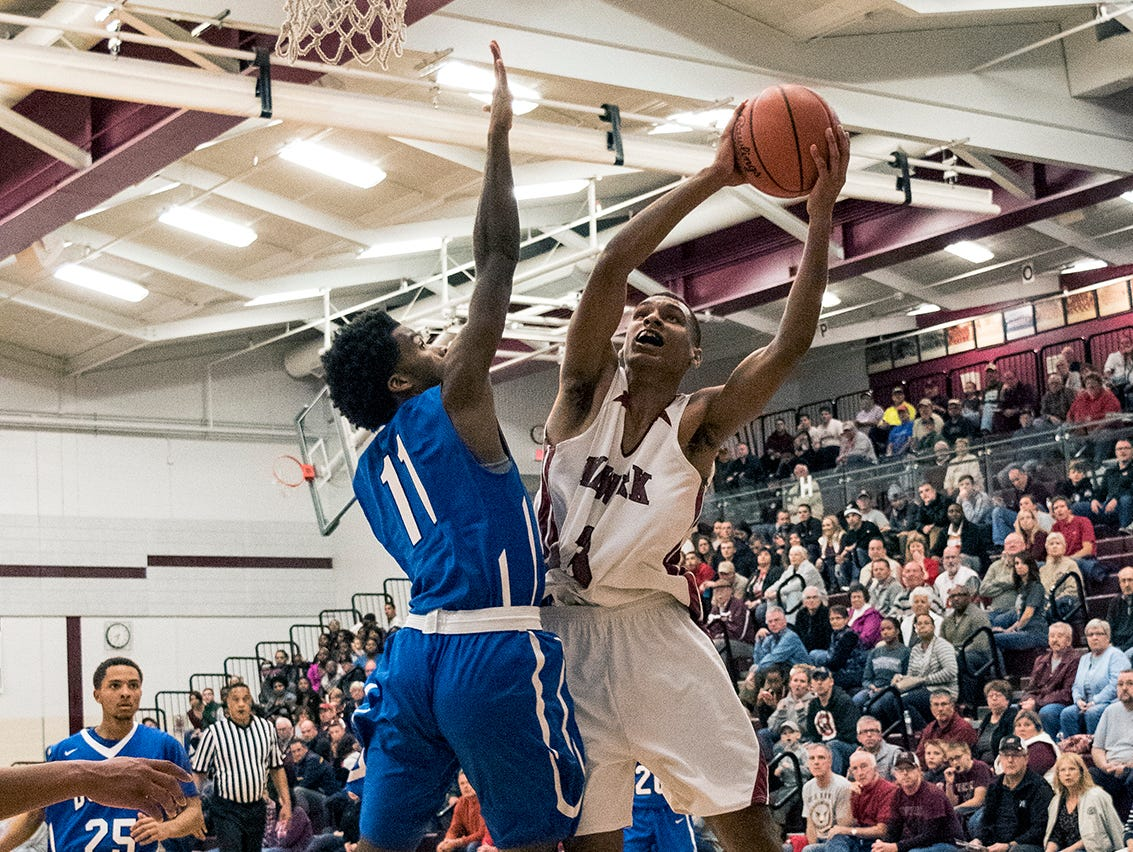 Newark junior Justin Carter goes up for the lay up Friday night at Jim Allen Gymnasium.