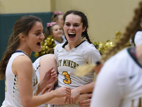 Manogue's Ashley Sprouse, center, and teammates celebrate a playoff win against Reed on Tuesday.