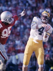 Jim Harbaugh releases a pass during Michigan's 26-24 victory over Ohio State in Columbus, Ohio, on Nov. 22, 1986.