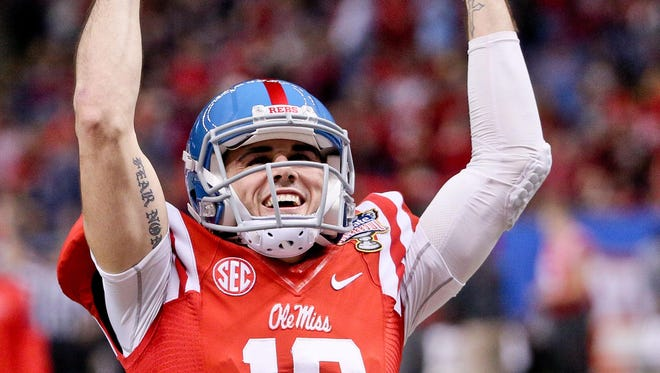 Jan 1, 2016; New Orleans, LA, USA; Ole Miss Rebels quarterback Chad Kelly (10) pumps up the crowd prior to kickoff in the 2016 Sugar Bowl against the Oklahoma State Cowboys at the Mercedes-Benz Superdome. Mandatory Credit: Derick E. Hingle-USA TODAY Sports
