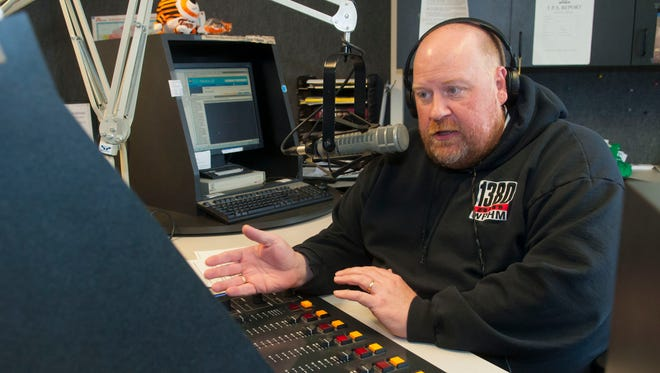 WPHM Radio broadcaster Paul Miller speaks on air Friday, March 10. Miller is the Grand Marshal of the St. Patrick's Day parade in Port Huron.
