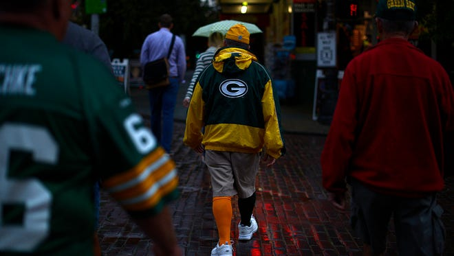 Cheeseheads roam the streets in downtown Seattle on Tuesday, Sept. 2, 2014.