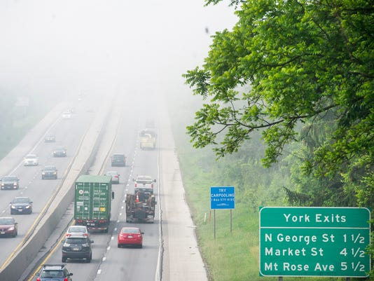 A foggy commute around 7:30 am Wednesday May 29, 2013 on Interstate 83 in Manchester Township.  YORK DAILY RECORD/SUNDAY NEWS - PAUL KUEHNEL