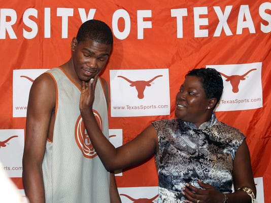 FILE - In this April 10, 2007, file photo, then-Texas basketball forward Kevin Durant, left, gets a pat from his mother, Wanda Pratt, after he announced he would enter the NBA draft during a news conference in Austin, Texas. Durant's mother, Wanda, is the subject of a Lifetime original movie called The Real MVP: The Wanda Durant Story, which will premiere on May 7. (AP Photo/Jack Plunkett, File)