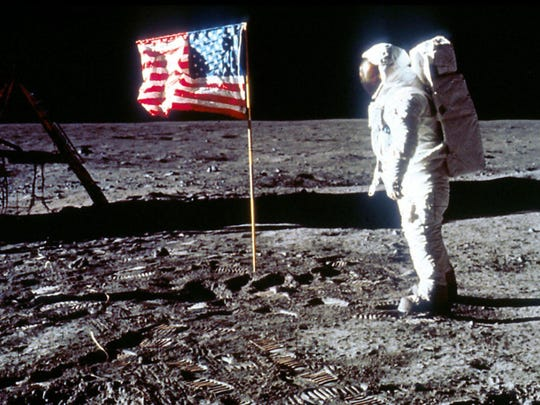 "Astronaut Edwin ""Buzz"" Aldrin poses next to the U.S. flag July 20, 1969 on the moon during the Apollo 11 mission."