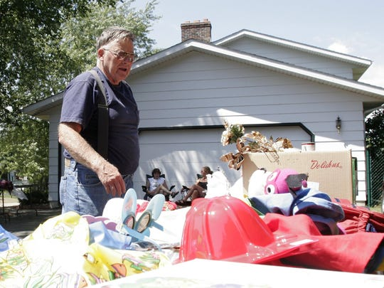 A Marshfield resident browses at a garage sale.