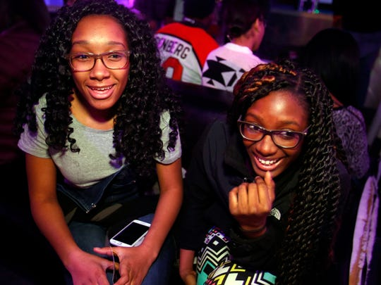 HIP-HOP SHOW FOR TEENS: Sisters Marcasia, 16, (left) and Ta'nasia Williams, 14, wait for the performances to start during an all-ages hip-hop show at Delaware Live in Prices Corner Friday.