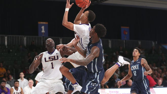 LSU Tigers guard Brandon Sampson (0) shoots past Old Dominion Monarchs forward Zoran Talley (24) during the second half in the 2016 Battle 4 Atlantis in the Imperial Arena at the Atlantis Resort.