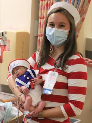Little Amaya Ortiz, of Randolph, a tiny Neonatal Intensive Care Unit sailor at Tufts Children's Hospital, made a big wave in paying tribute to the hospital's history and wishing everyone a Happy Halloween. Amaya is held by NICU nurse Jennie Winsper. NICU nurses Molly Simeone, RN, and Camille Hally, RN, made all the costumes.