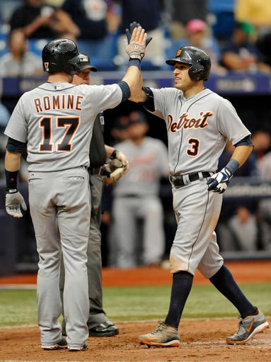 Tigers' Andrew Romine, left, congratulates teammate
