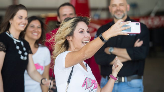 I Hart Flying Foundation founder Rachelle Spector takes a selfie after a press conference announcing their partnership with Southern Utah University's Aviation program designed to encourage women to be pilots at the Cedar City Airport Tuesday, June 5, 2018.