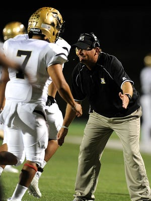 Abilene High head coach Del Van Cox congratulates his players after a touchdown in the second quarter of the Eagles' 56-31 win over Keller Timber Creek on Nov. 3, 2016, at Keller Athletic Complex.
