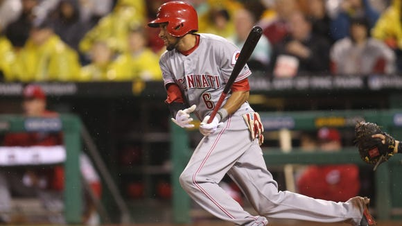 Reds center fielder Billy Hamilton singles against the Pirates during Friday night's loss.