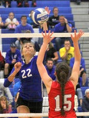 Emily Crowell of Horseheads tips the ball to Baldwinsville's