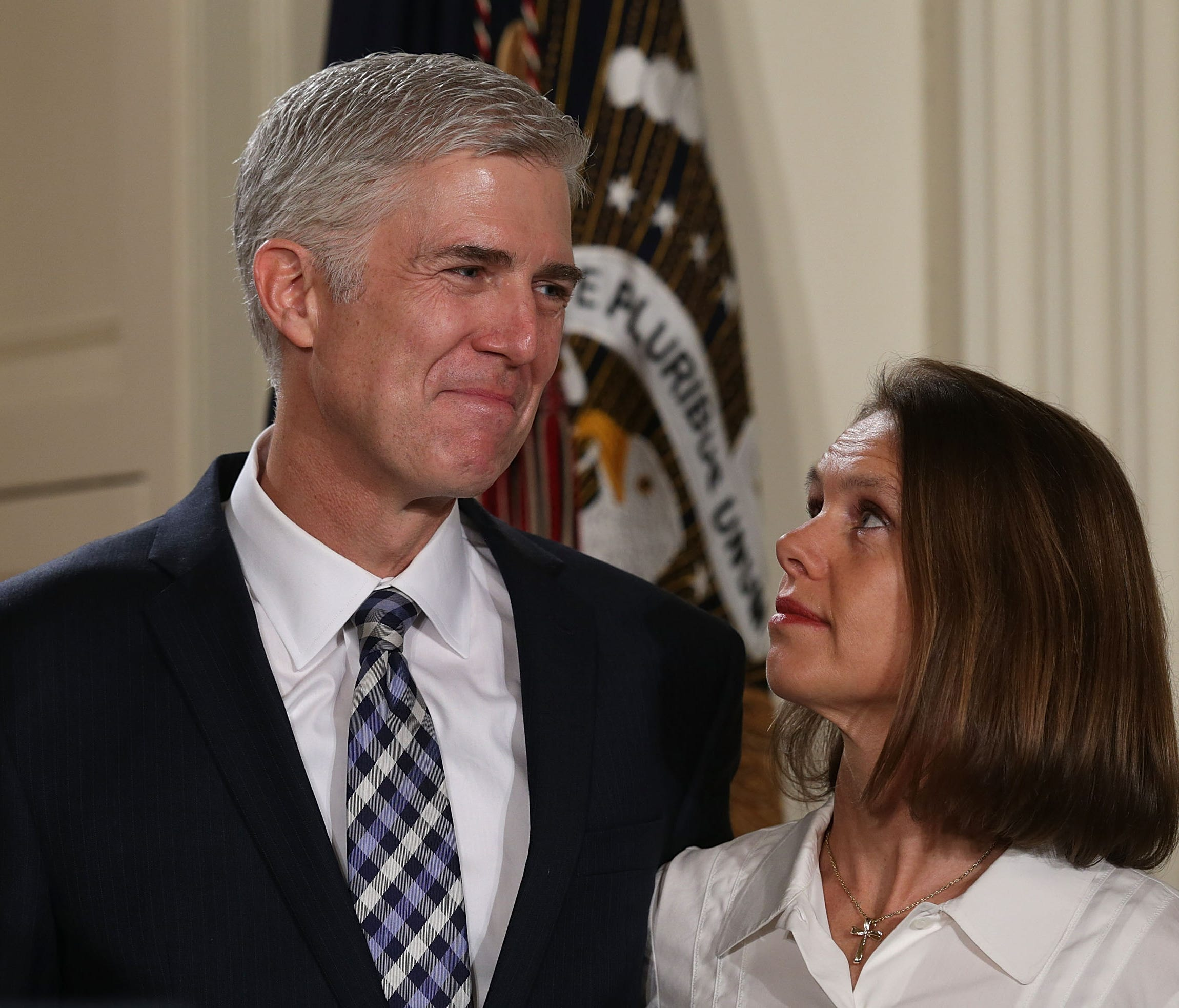 Federal appeals court judge Neil Gorsuch and his wife, Louise, listen as President Trump introduces the Supreme Court nominee Jan. 31 in the East Room of the White House.