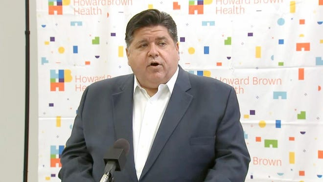 Gov. JB Pritzker announces the release of $140 million in federally-funded grants to Federally Qualified Health Centers, safety net hospitals and long-term care facilities during a news conference Friday at Howard Brown Health Center in Chicago.