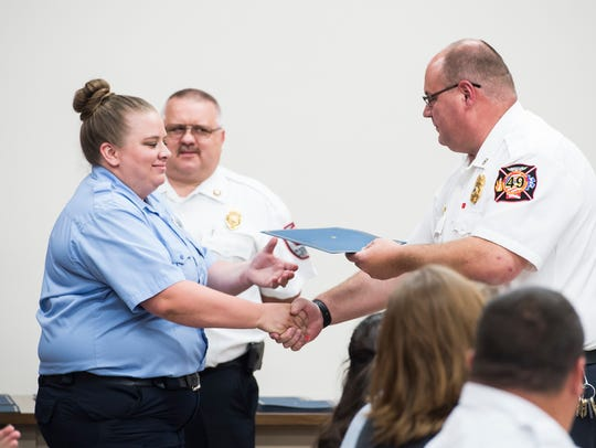 Casey Smith is awarded the EMS Life Saving Award during
