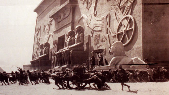 "Hundreds of costumed actors and extras performs in front of  a 10-story wood-and-plaster Egyptian city set constructed for production of Cecil B. DeMille's ""The Ten Commandments,"" near the town of Guadalupe on the wind-swept Central Coast of California in 1923."