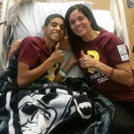 Josh Villarreal, 14, and his mother Lorina Villarreal, 40, give a thumbs up in a photo taken Friday, Aug. 22, 2014, at the Lucile Packard Children's Hospital at Stanford University.