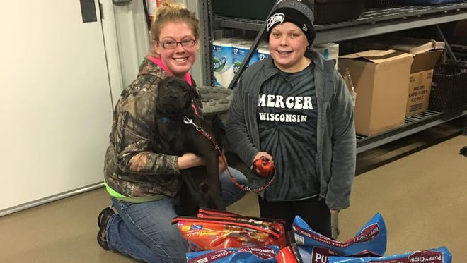 The Lincoln County Humane Society would like to thank Emily Dinges of Merrill. For several years, Emily has sold candy bars at Ed & Sharon's Restaurant in order to raise money for the shelter. This year, Emily donated several bags of cat and dog food to the animals calling the shelter their temporary home. Pictured with Emily (right) is Amber from the Lincoln County Humane Society.