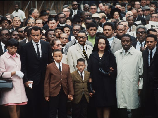"Dr. Martin Luther King Jr.'s widow, Coretta Scott King,  and three of the couple's four children led a memorial march through downtown Memphis Monday April 8, 1968. Rev. Ralph Abernathy and many other well known civil rights and union leaders were among an estimated 19,000 people from across the nation participating. Mrs. King and others spoke to the mass of mourners from a platform at City Hall plaza. ""Those of you who believe in what Martin Luther King stood for - I would challenge you today to see that his spirit never dies. We are going to continue his work to make all people truly free and to make every person feel he is a human being,"" said Mrs. King. At the time of his death, April 4, Dr. King was on his third visit to Memphis in support of striking sanitation workers."