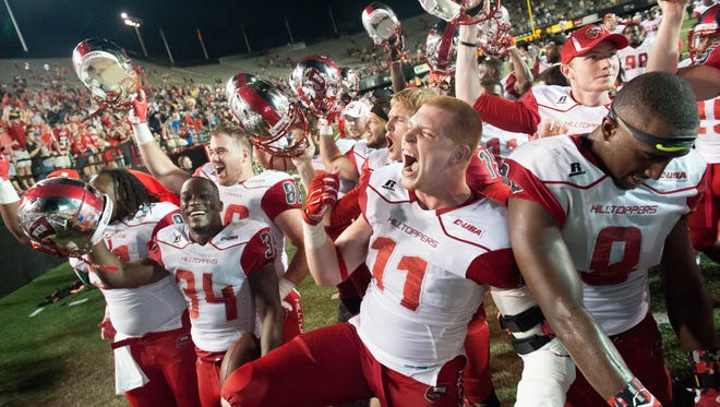 Sep 3, 2015; Nashville, TN, USA; Western Kentucky Hilltoppers players celebrate after the second half after defeating Vanderbilt Commodores 14-12 at Vanderbilt Stadium. Western Kentucky Hilltoppers won 14-12. Mandatory Credit: Joshua Lindsey-USA TODAY Sports