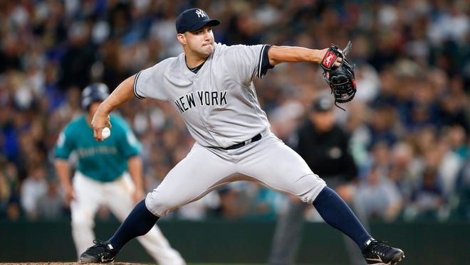 New York Yankees relief pitcher Tommy Kahnle (48) throws against the Seattle Mariners during the sixth inning at Safeco Field on July 21, 2017.