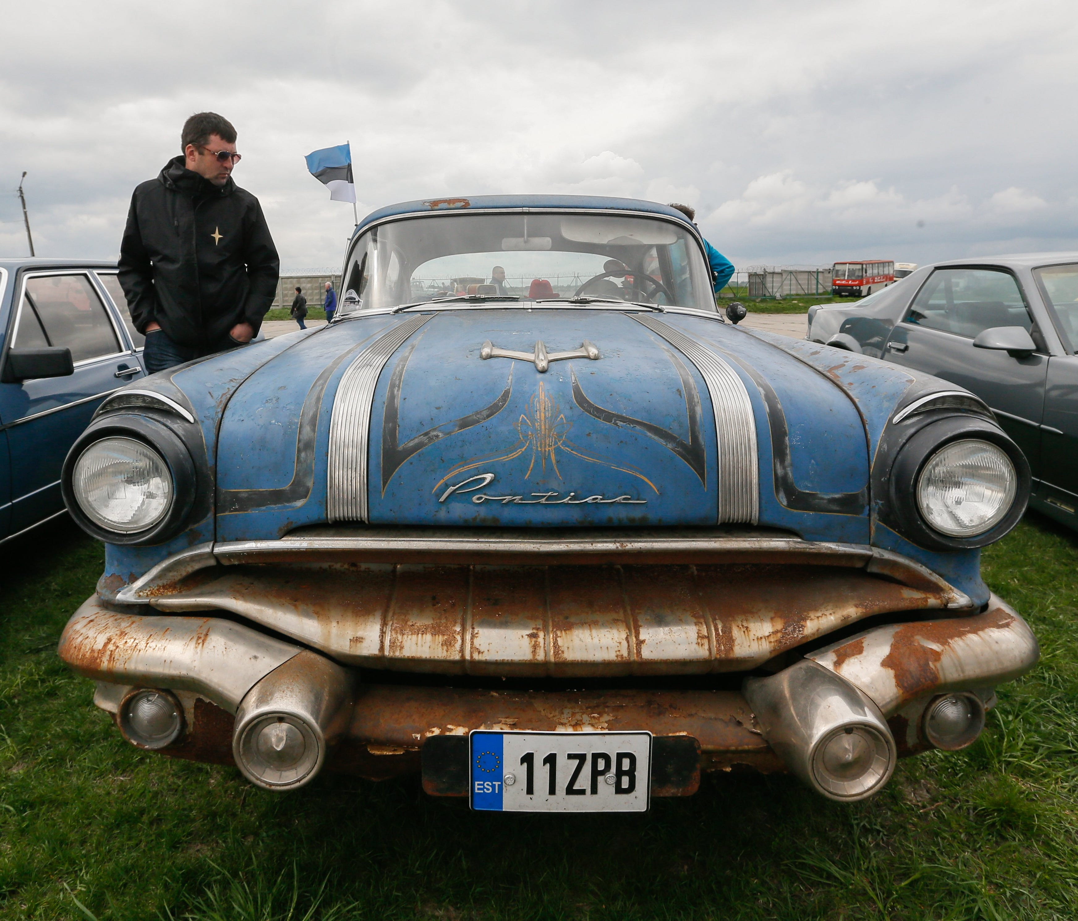 A visitor looks at a Pontiac Chieftain made in 1956 during the 'OldCarLand' motor show in Kiev last month. About 1,000 old and exclusive cars and motorcycles were presented at the Ukrainian Aviation museum.