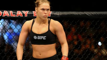 Ronda Rousey prepares to begin a women's bantamweight championship defense against Sara McMann during the main event of UFC 170 at Mandalay Bay.  Rousey won by submission.