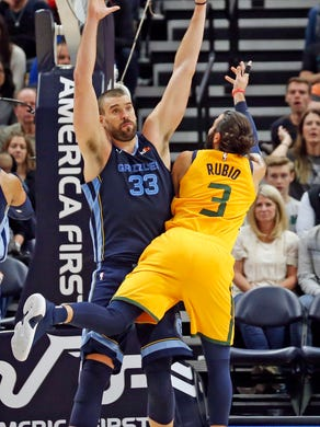 Memphis Grizzlies center Marc Gasol (33) defends as Utah Jazz guard Ricky Rubio (3) shoots in the first half of an NBA basketball game, Monday, Oct. 22, 2018, in Salt Lake City. (AP Photo/Rick Bowmer)