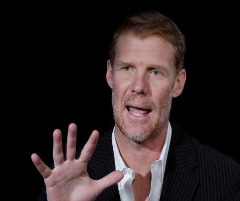 Alexi Lalas talks during an interview, Wednesday, May 30, 2018, in New York. Lalas will be part of Fox Sports coverage of the 2018 FIFA World Cup. (AP Photo/Mark Lennihan) ORG XMIT: NYML603