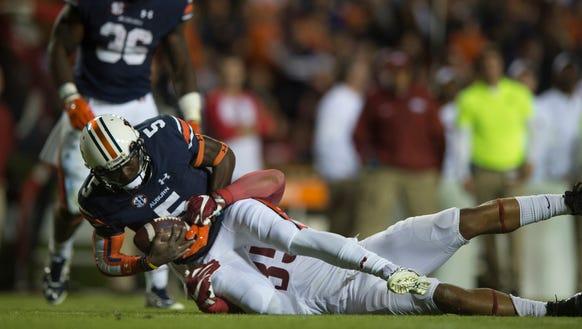 Auburn quarterback John Franklin III (5) dives forward