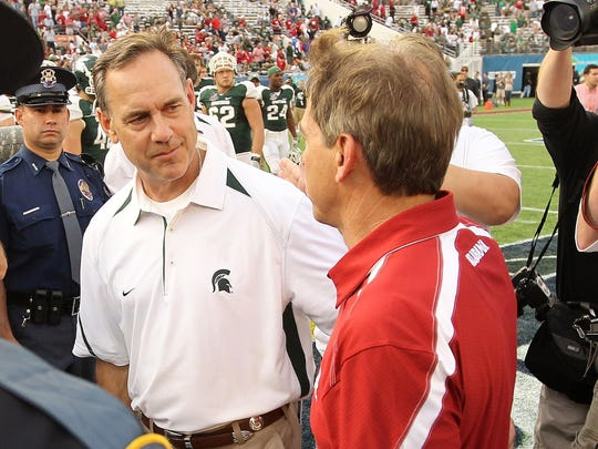 Michigan State coach Mark Dantonio congratulates Nick Saban on Alabama's Capital One Bowl win in 2011.