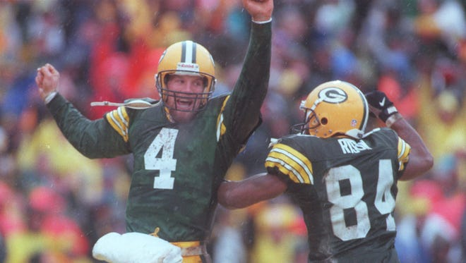 Brett Favre and Andre Rison celebrate Rison's touchdown during the divisional playoff game against San Francisco in 1997. Green Bay won 35-14.