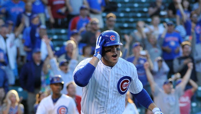 Chicago Cubs first baseman Anthony Rizzo (44) hits a walk-off two run homer against the Miami Marlins at Wrigley Field. The Chicago Cubs defeated the Miami Marlins 5-3 in 13 innings.