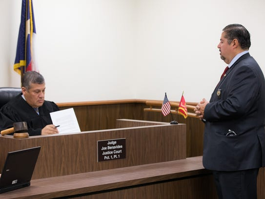 Lawyer Joe Flores (right) files a motion Tuesday, Oct.
