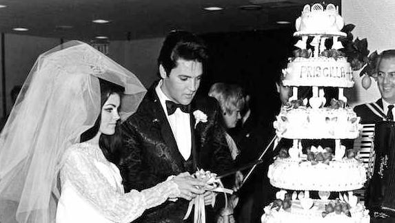 Elvis and Priscilla Presley cut their wedding cake after exchanging vows in the Aladdin Hotel-Casino in Las Vegas in this 1967 photo.